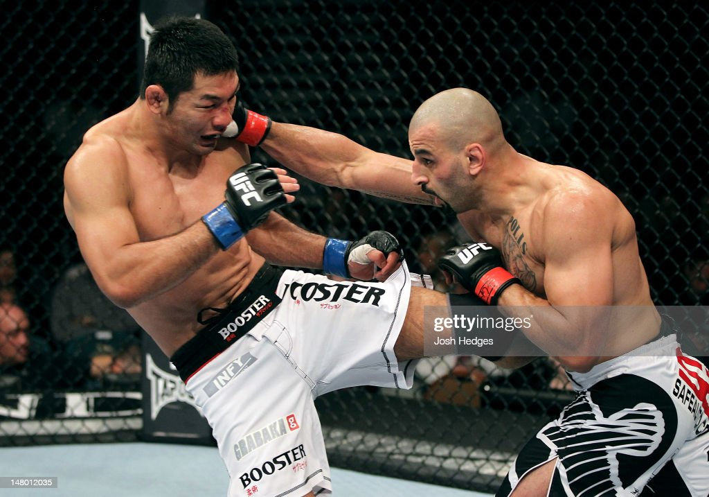 Riki Fukuda and Costa Philippou exchange strikes during their middleweight bout at UFC 148 inside MGM Grand Garden Arena on July 7, 2012 in Las Vegas, Nevada.