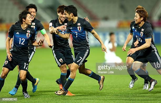 Riki Harakawa of Japan celebrates scoring the winning goal during the AFC U23 Championship semi final match between Japan and Iraq at the Abdullah...