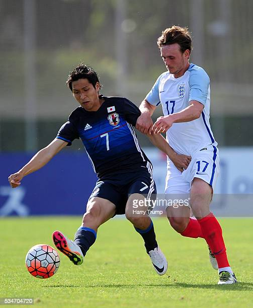 Riki Harakawa of Japan is tackled by John Swift of England during the Toulon Tournament match between Japan and England at the Stade Leo Lagrange on...