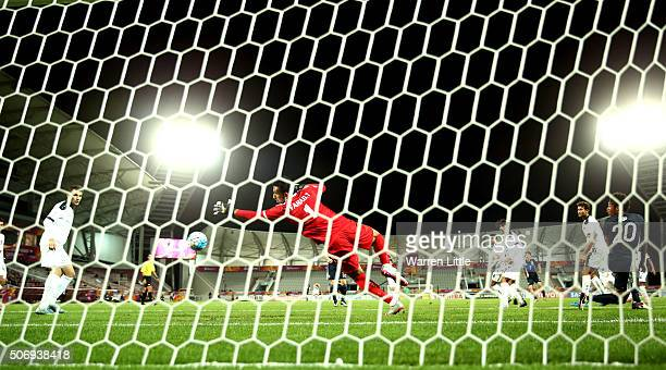 Riki Harakawa of Japan scores the winning goal during the AFC U23 Championship semi final match between Japan and Iraq at the Abdullah Bin Khalifa...