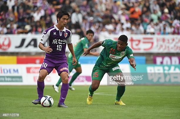 Riki Harakawa of Kyoto Sanga passes the ball under the pressure from Henik of FC Gifu during the JLeague 2nd division match between Kyoto Sanga and...