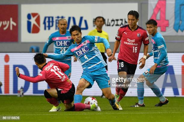 Riki Harakawa of Sagan Tosu and Hotaru Yamaguchi of Cerezo Osaka compete for the ball during the JLeague J1 match between Sagan Tosu and Cerezo Osaka...
