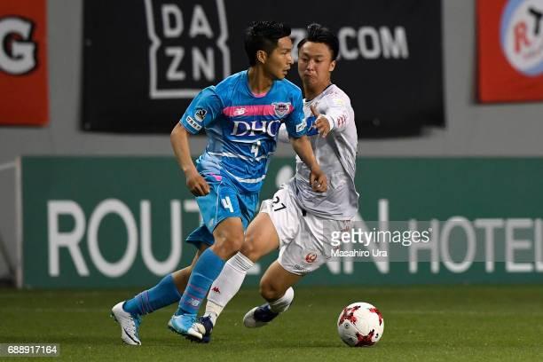 Riki Harakawa of Sagan Tosu and Takuma Arano of Consadole Sapporo compete for the ball during the JLeague J1 match between Sagan Tosu and Consadole...