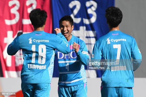 Riki Harakawa of Sagan Tosu celebrates scoring the opening goal with his team mates Takamitsu Tomiyama and Daichi Kamada during the JLeague J1 match...