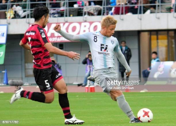 Riki Matsuda of Avispa Fukuoka and Kazuhito Watanabe of Fagiano Okayama compete for the ball during the JLeague J2 match between Fagiano Okayama and...