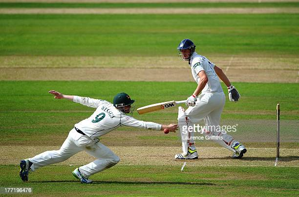 Riki Wessels of Nottinghamshire dives at full stretch to try and catch Steve Patterson of Yorkshire during day two of the LV County Championship...
