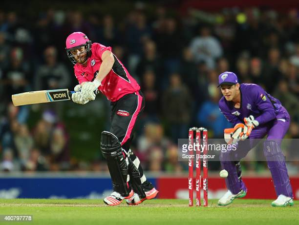 Riki Wessels of the Sixers bats as wicketkeeper Tim Paine of the Hurricanes looks on during the Big Bash League match between the Hobart Hurricanes...