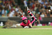 Riki Wessels of the Sixers slides in to avoid a runout during the Big Bash League match between the Sydney Sixers and the Sydney Thunder at Sydney...