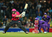 Riki Wessels of the Sixers switch hits as wicketkeeper Tim Paine of the Hurricanes looks on during the Big Bash League match between the Hobart...