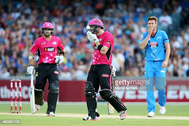Riki Wessels of the Sydney Sixers takes off his helmet after a ball bowled by Kane Richardson of the Adelaide Strikers hit him and got stuck in the...