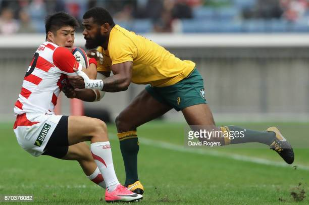 Rikiya Matsuda of Japan is tackled by Marika Koroibete during the rugby union international match between Japan and Australia Wallabies at Nissan...