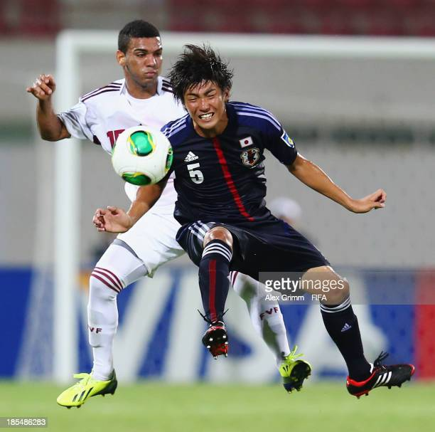 Rikiya Motegi of Japan is challenged by Jose Caraballo of Venezuela during the FIFA U17 World Cup UAE 2013 Group D match between Japan and Venezuela...
