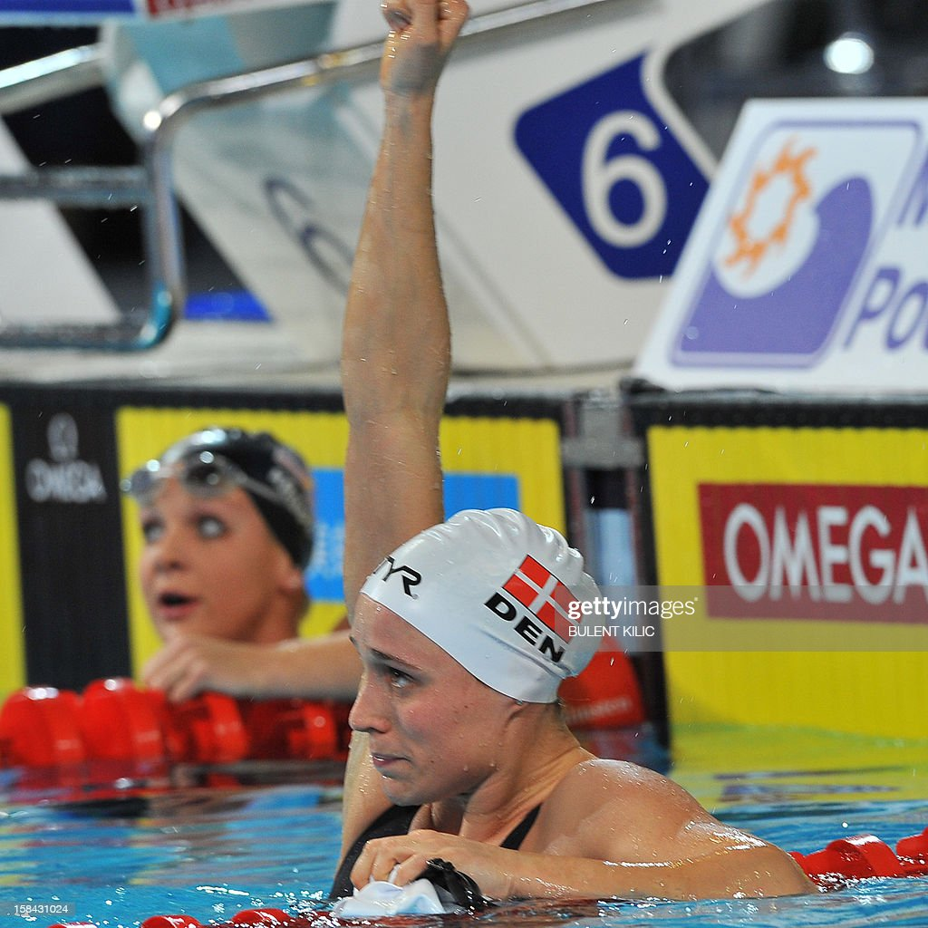 Rikke Moeller Pedersen of Denmark celebrates after winning gold in the women's 200m breaststroke final during the Short Course Swimming World Championships in Istanbul on December 16, 2012.