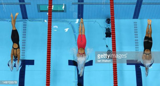 Rikke Pedersen of Denmark Rebecca Soni of the United States and Satomi Suzuki of Japan compete in the Women's 200m Breaststroke Final on Day 6 of the...