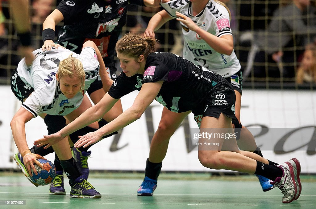 Rikke Riber Zachariassen of Team Esbjerg and Line Jorgensen of FCM Handbold figths for the ball during the Danish Boxer Dameligaen women's match between FCM Handbold and Team Esbjerg at IBF Arena on January 17, 2015 in Ikast, Denmark.