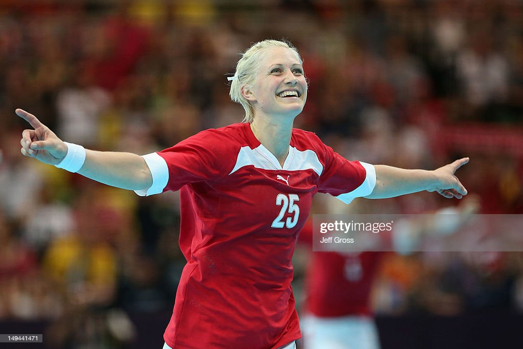 Rikke Skov of Denmark celebrates winning 21-18 in the Women's Handball preliminaries Group B - Match 4 between Denmark and Sweden on Day 1 of the London 2012 Olympic Games at the Copper Box on July 28, 2012 in London, England.