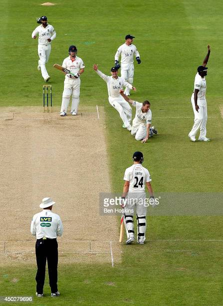 Rikki Clarke and his team mate appeal successfully for the wicket of Steven Croft of Lancashire during the LV County Championship match between...