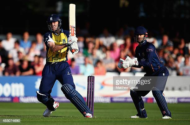 Rikki Clarke of Birminghsm Bears hits the ball towards the boundary as James Foster of Essex Eagles looks on during the Natwest T20 Blast Quarter...