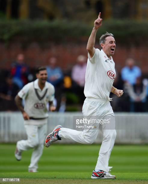 Rikki Clarke of Surrey celebrates after dismissing Tim Rouse of Somerset during the Specsavers County Championship Division One match between...