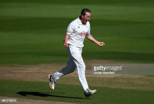 Rikki Clarke of Surrey celebrates dismissing Tom Abell of Somerset during day four of the Specsavers County Championship Division One match between...