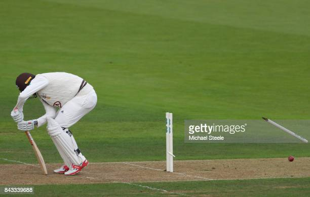 Rikki Clarke of Surrey is bowled by Fidel Edwards of Hampshire during day two of the Specsavers County Championship Division One match between...