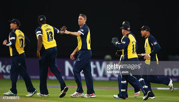 Rikki Clarke of Warwickshire is congratulated on the wicket of Riki Wessels of Nottinghamshire during the NatWest T20 Blast match between...