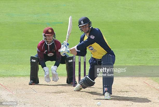 Rikki Clarke of Warwickshire plays a shot as Ben Duckett of Northants looks on during the NatWest T20 Blast Semifinal between Northamptonshire and...