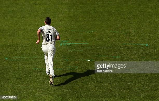 Rikki Clarke of Warwickshire runs in to bowl during the LV County Championship match between Warwickshire and Lancashire at Edgbaston on June 8 2014...