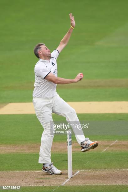 Rikki Clarke of Warwickshire runs into bowl during the Specsavers County Championship Division One match between Warwickshire and Lancashire at...