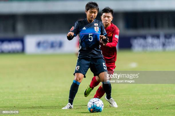Riko Ushijima of Japan fights for the ball with Tuyet Ngan of Vietnam during their AFC U19 Women'u2019s Championship 2017 Group Stage B match between...