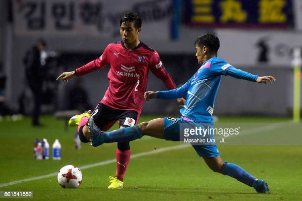 Riku Matsuda of Cerezo Osaka and Akito Fukuta of Sagan Tosu compete for the ball during the JLeague J1 match between Sagan Tosu and Cerezo Osaka at...