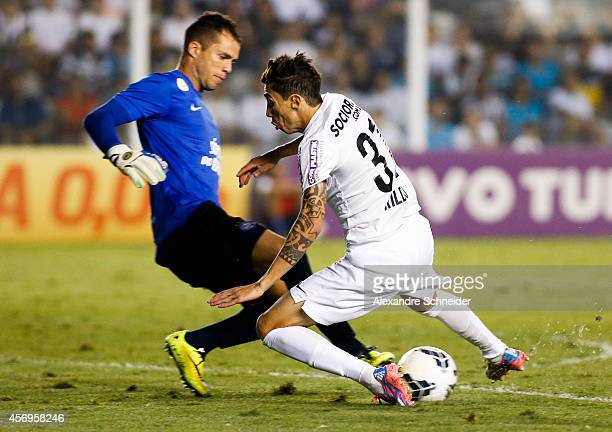 Rildo of Santos and Marcelo Lomba of Bahia in action during the match between Santos and Bahia for the Brazilian Series A 2014 at Vila Belmiro...