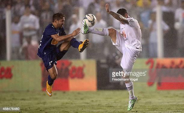 Rildo of Santos fights for the ball with Everton of Cruzeiro during the match between Santos and Cruzeiro for Copa do Brasil 2014 at Vila Belmiro...