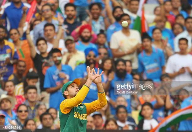 Rilee Rossouw of South Africa takes a catch to dismiss Suresh Raina of India as Indian fans in the crowd watch on during the 2015 ICC Cricket World...