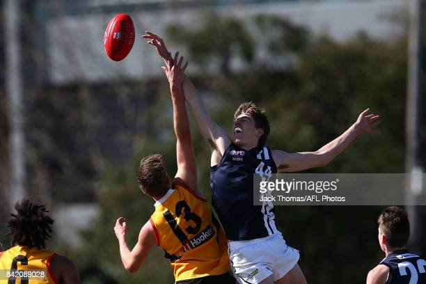Riley Bowman of the Dandenong Stingrays and Jordon Reid of the Geelong Falcons compete for the ball during the TAC Cup round 18 match between Geelong...