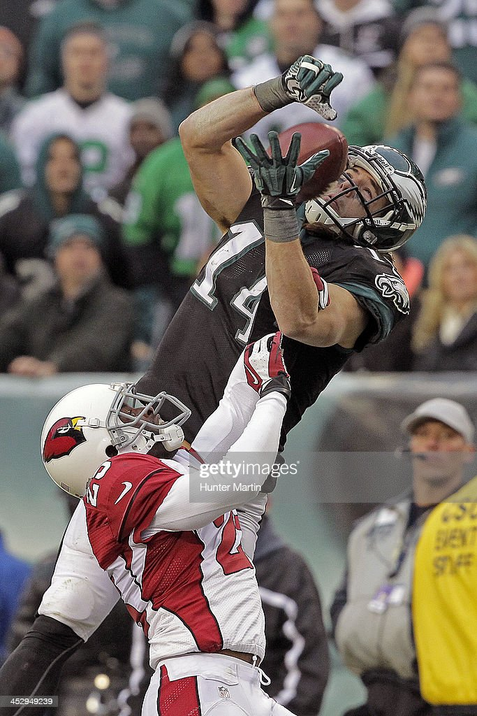 <a gi-track='captionPersonalityLinkClicked' href=/galleries/search?phrase=Riley+Cooper&family=editorial&specificpeople=4099675 ng-click='$event.stopPropagation()'>Riley Cooper</a> #14 of the Philadelphia Eagles attempts to catch a pass as <a gi-track='captionPersonalityLinkClicked' href=/galleries/search?phrase=Jerraud+Powers&family=editorial&specificpeople=3234010 ng-click='$event.stopPropagation()'>Jerraud Powers</a> #25 of the Arizona Cardinals defends during a game on December 1, 2013 at Lincoln Financial Field in Philadelphia, Pennsylvania. The Eagles won 24-21.
