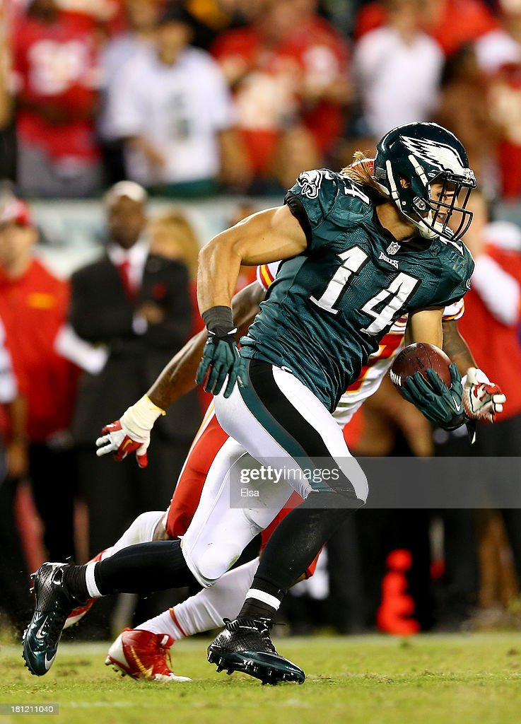 Riley Cooper #14 of the Philadelphia Eagles carries the ball as Sean Smith #27 of the Kansas City Chiefs defends on September 19, 2013 at Lincoln Financial Field in Philadelphia, Pennslyvania. The Kansas City Chiefs defeated the Philadelphia Eagles 26-16.