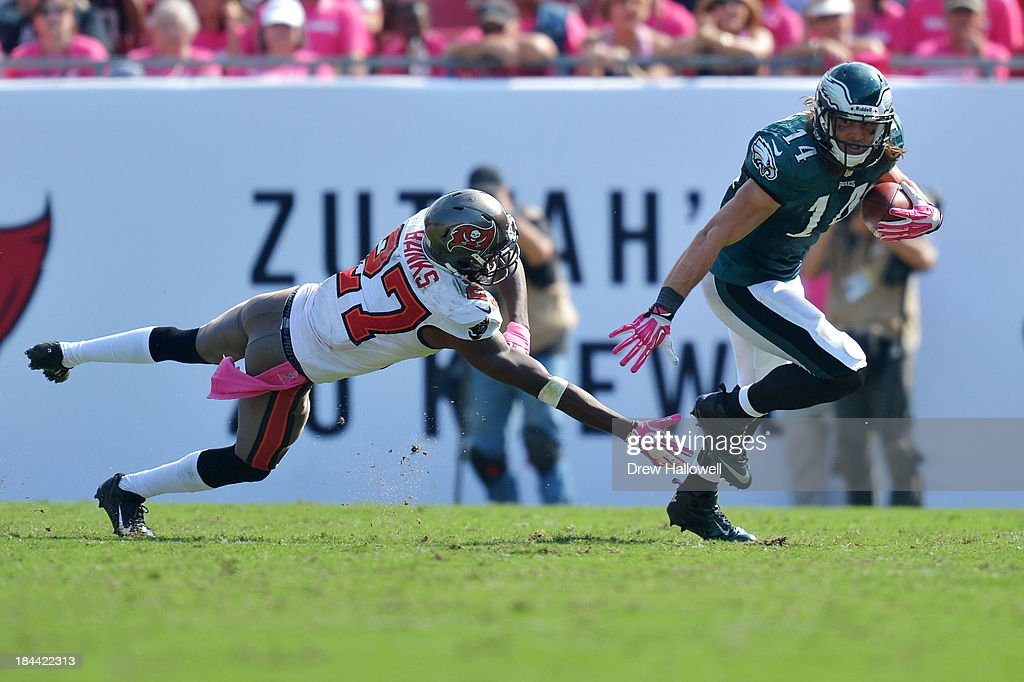 <a gi-track='captionPersonalityLinkClicked' href=/galleries/search?phrase=Riley+Cooper&family=editorial&specificpeople=4099675 ng-click='$event.stopPropagation()'>Riley Cooper</a> #14 of the Philadelphia Eagles evades Johnthan Banks #27 of the Tampa Bay Buccaneers at Raymond James Stadium on October 13, 2013 in Tampa, Florida. The Eagles won 30-21.