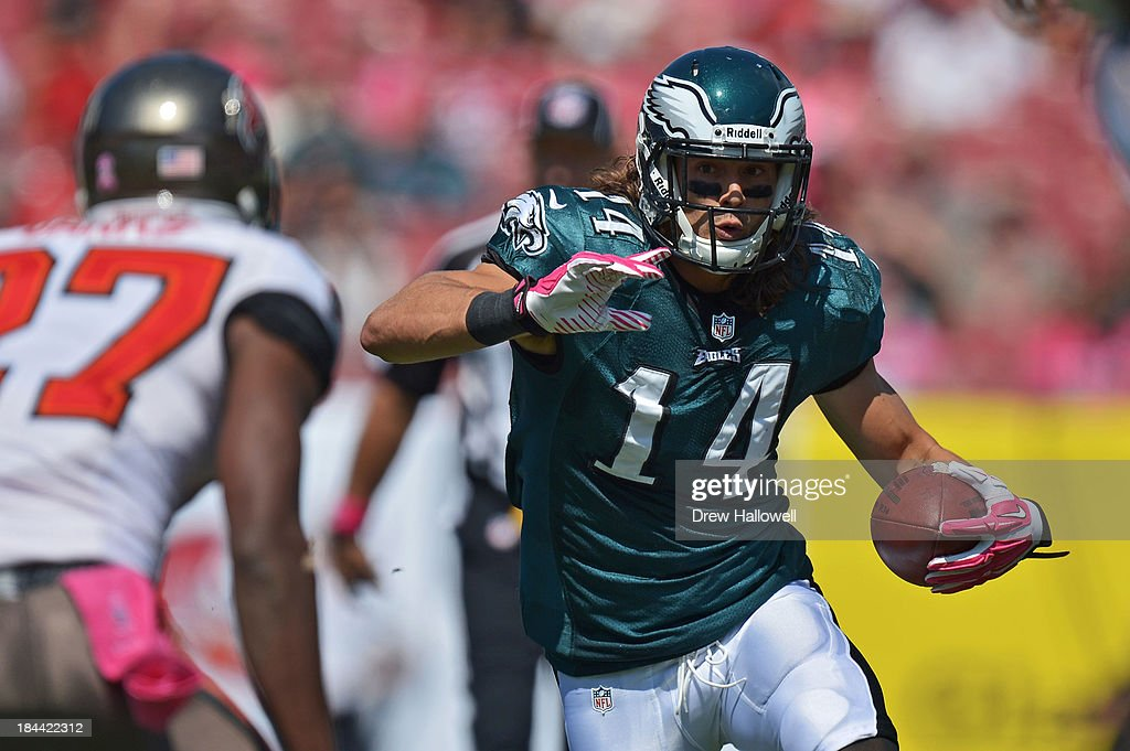 <a gi-track='captionPersonalityLinkClicked' href=/galleries/search?phrase=Riley+Cooper&family=editorial&specificpeople=4099675 ng-click='$event.stopPropagation()'>Riley Cooper</a> #14 of the Philadelphia Eagles runs the ball against the Tampa Bay Buccaneers at Raymond James Stadium on October 13, 2013 in Tampa, Florida. The Eagles won 30-21.