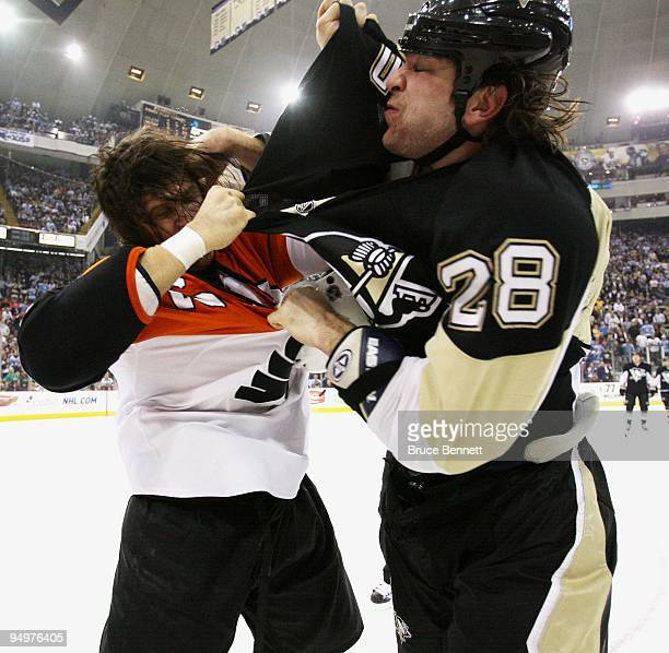 Riley Cote of the Philadelphia Flyers and Eric Godard of the Pittsburgh Penguins fight during the first period at the Mellon Arena on December 15...