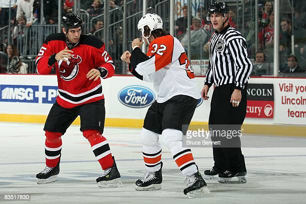 Riley Cote of the Philadelphia Flyers fights against PierreLuc LetourneauLeblond of the New Jersey Devils during the game on October 24 2008 at the...