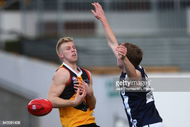 Riley D'arcy of the Dandenong Stingrays attempts to mark the ball during the TAC Cup round 18 match between Geelong and Dandenong at Victoria Park on...
