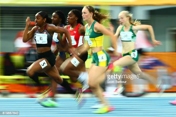 Riley Day of Australia and Deondra Green of Canada compete in the Girls 100m Semifinal 1 during the Athletics on day 3 of the 2017 Youth Commonwealth...
