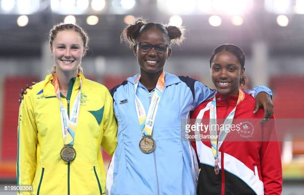 Riley Day of Australia Julien Alfred of Saint Lucia and Deondra Green of Canada pose during the medal ceremony for the Girls 1500m Final during the...