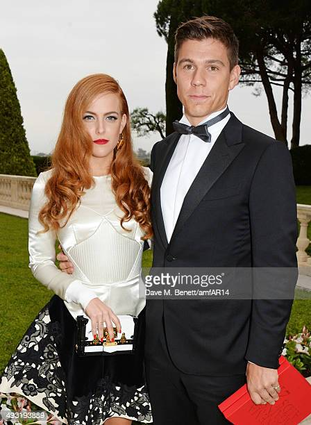 Riley Keough and Ben SmithPetersen attend amfAR's 21st Cinema Against AIDS Gala presented by WORLDVIEW BOLD FILMS and BVLGARI at Hotel du CapEdenRoc...