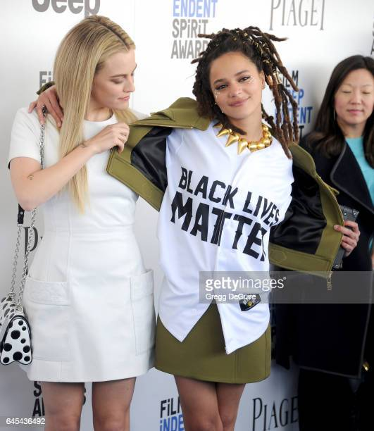 Riley Keough and Sasha Lane arrive at the 2017 Film Independent Spirit Awards on February 25 2017 in Santa Monica California
