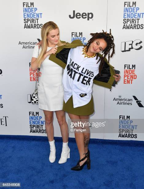 Riley Keough and Sasha Lane arrive at the Independent Spirit Awards on February 25 2017 in Santa Monica California Monte is wearing a 'Black Lives...
