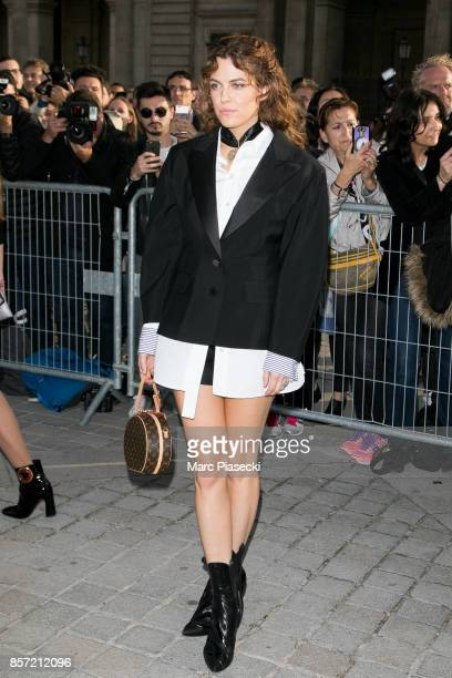Riley Keough attends the 'Louis Vuitton' fashion show at Louvre Pyramid on October 3 2017 in Paris France