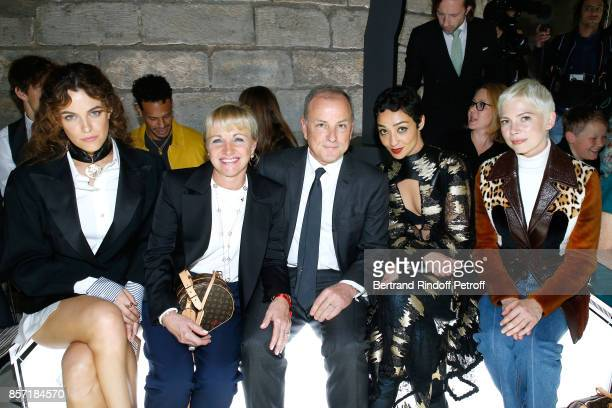 Riley Keough Chief Executive Officer of Louis Vuitton Michael Burke his wife Brigitte Burke Ruth Negga Michelle Williams attend the Louis Vuitton...