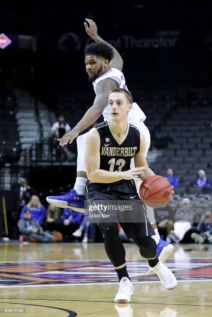 Riley LaChance #13 of the Vanderbilt Commodores works past Myles Powell #13 of the Seton Hall Pirates in the second half during their NIT Season Tip Off tournament game at Barclays Center on November 24, 2017 in the Brooklyn brough of New York City.